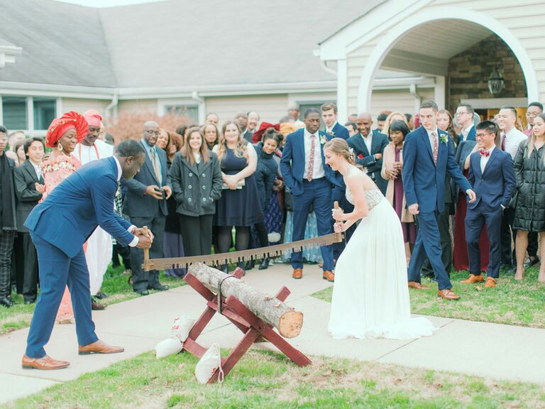 Bride and groom cutting tree stump during German log-cutting unity ceremony