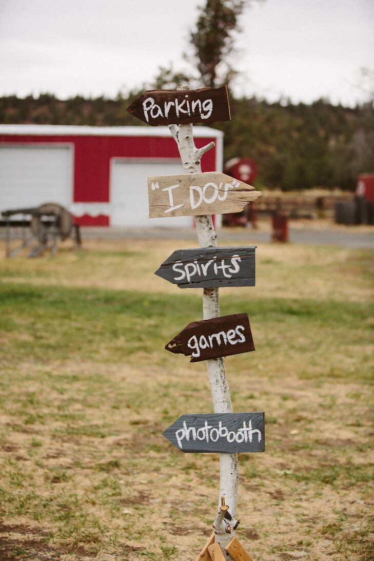 Rustic DIY signs directed guests to the wedding event at Long Hollow Ranch in Sisters, Oregon.