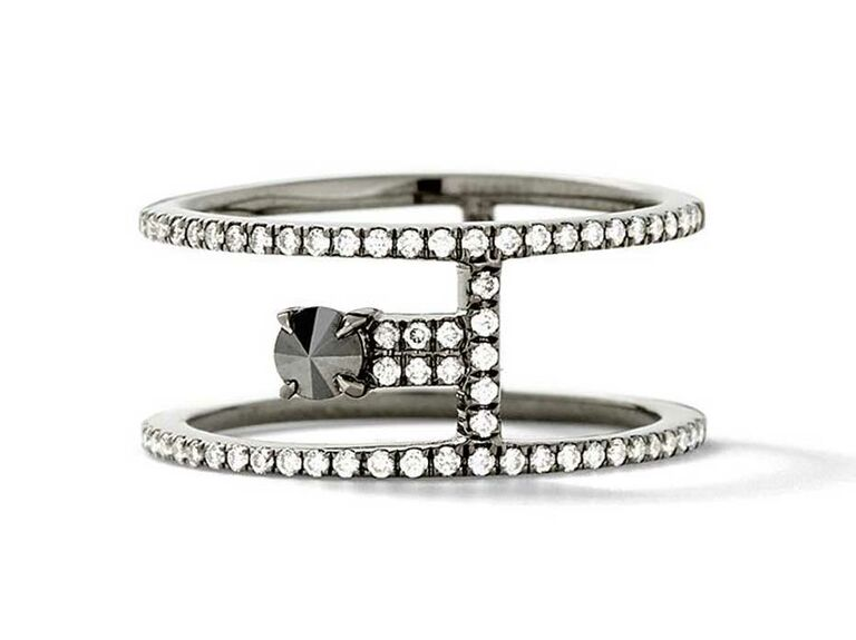 Black diamond engagement ring in between two pavé bands