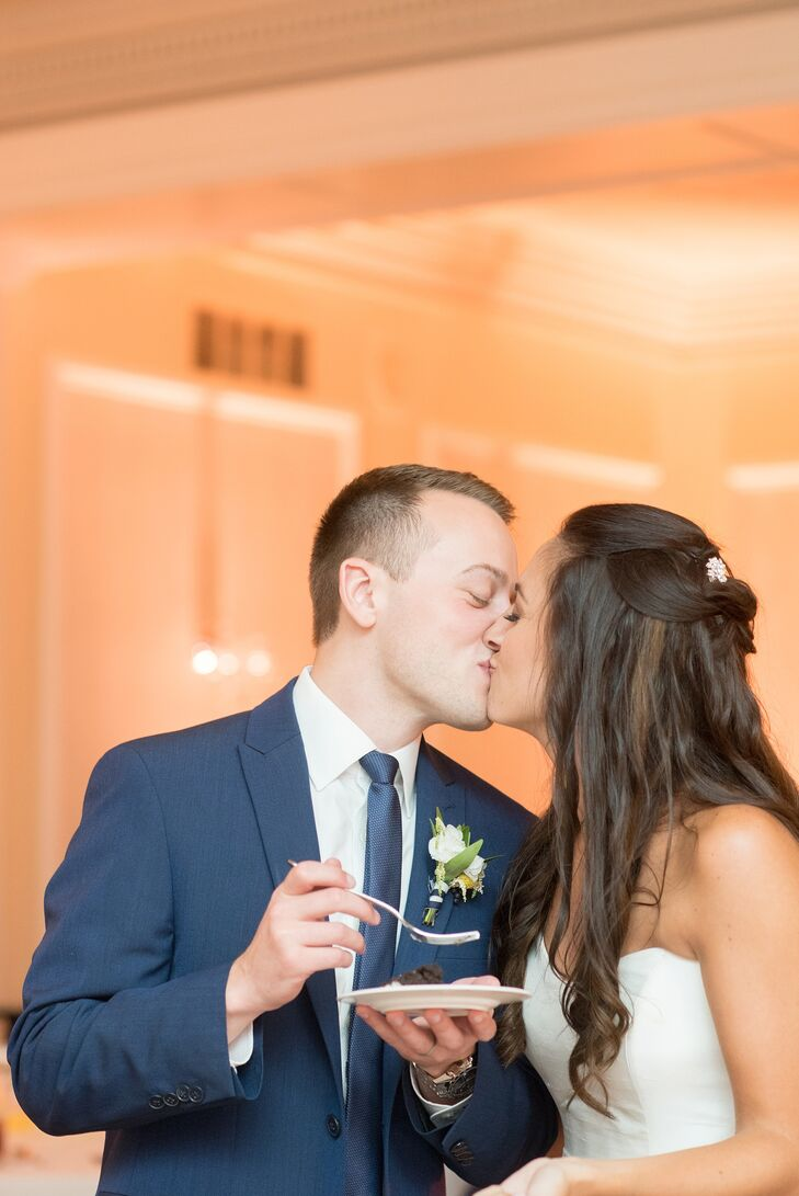 After Pam and Sean took a few bites of their cake, the pair also shared a kiss. Sean stood behind her in a modern, slim-fit suit by Calvin Klein. Matching his groomsmen, he wore a white monogrammed shirt, patterned blue tie and a white boutonniere. Their florist wrapped each stem in the couple's nautical blue-and-white-striped pattern.