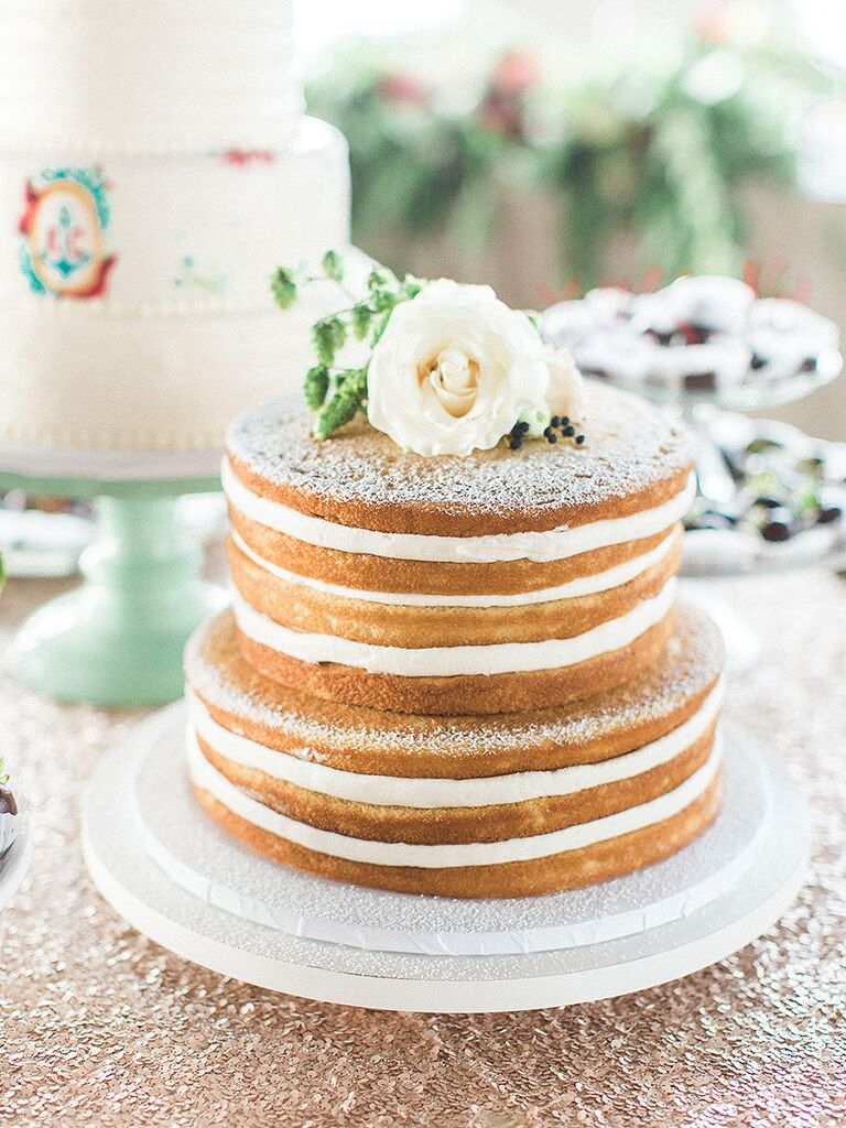 Two-tier naked wedding cake with white floral cake topper