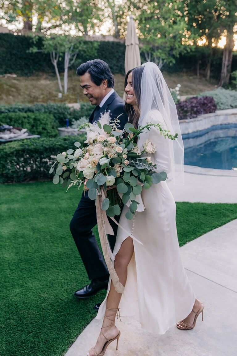erin lim's dad walks her down on the aisle on her wedding day