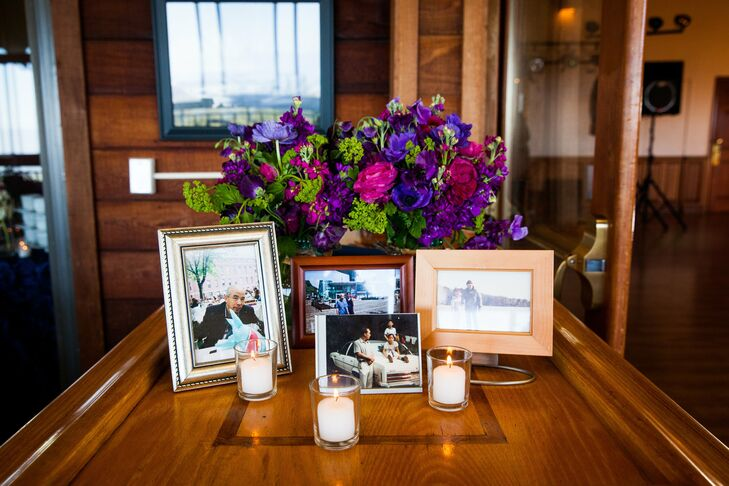 Guests paused at a table filled with old family photos at the entrance to the reception area.