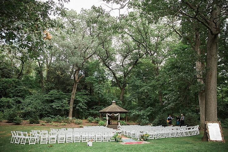 Andi and Eric exchanged vows framed by a rustic gazebo surrounded by nature.