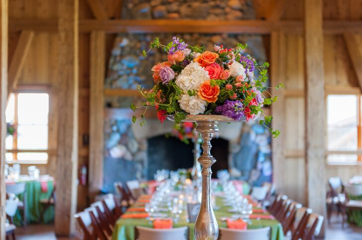 The reception tables were decorated with white hydrangeas, orange roses and purple hyacinth.