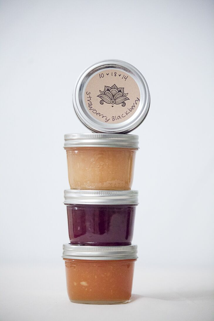 Sophia and Randy jarred a variety of homemade jams for guests to take home as wedding favors. The different fruit flavors conveniently matched the wedding's ivory, plum, and pink color palette.