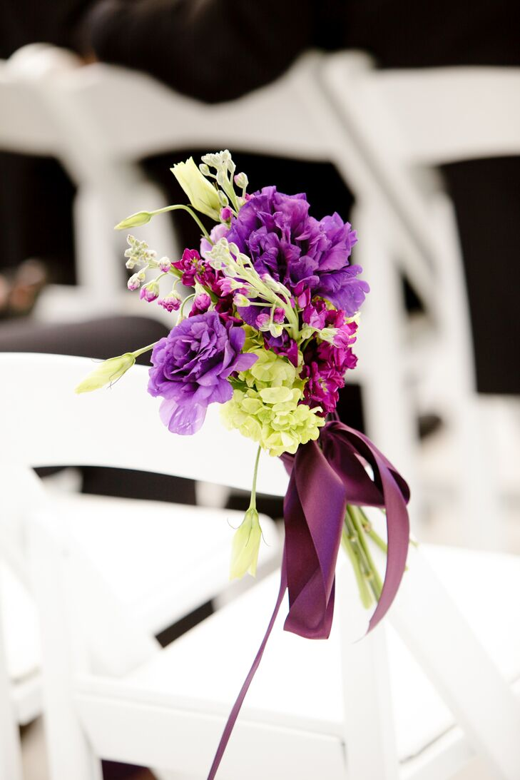 Marzetta and Brian decorated their white tented ceremony with rows of white folding chairs as arrangements of purple peonies, green hydrangea and purple delphiniums were placed along the aisle.