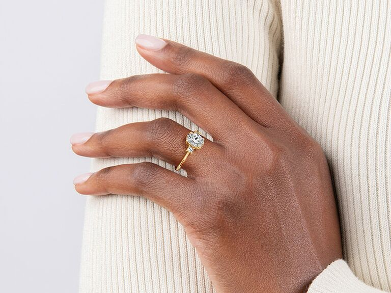 Lab grown diamond engagement ring on hand