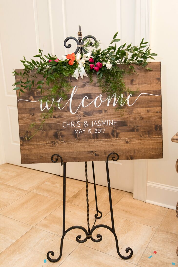 Rustic wooden welcome signs set the tone for the couple's wine-country nuptials at Morais Vineyards & Winery in Bealeton, Virginia.