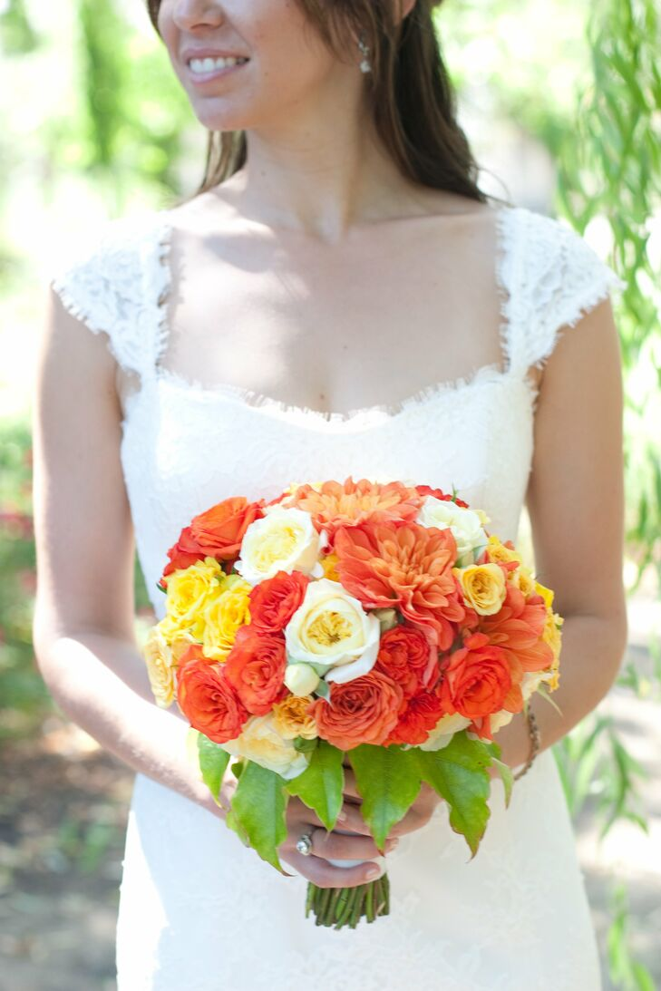 Patience garden roses, bright lemon and carnelian spray roses, local dahlias and leaves made up Sara's striking bouquet.