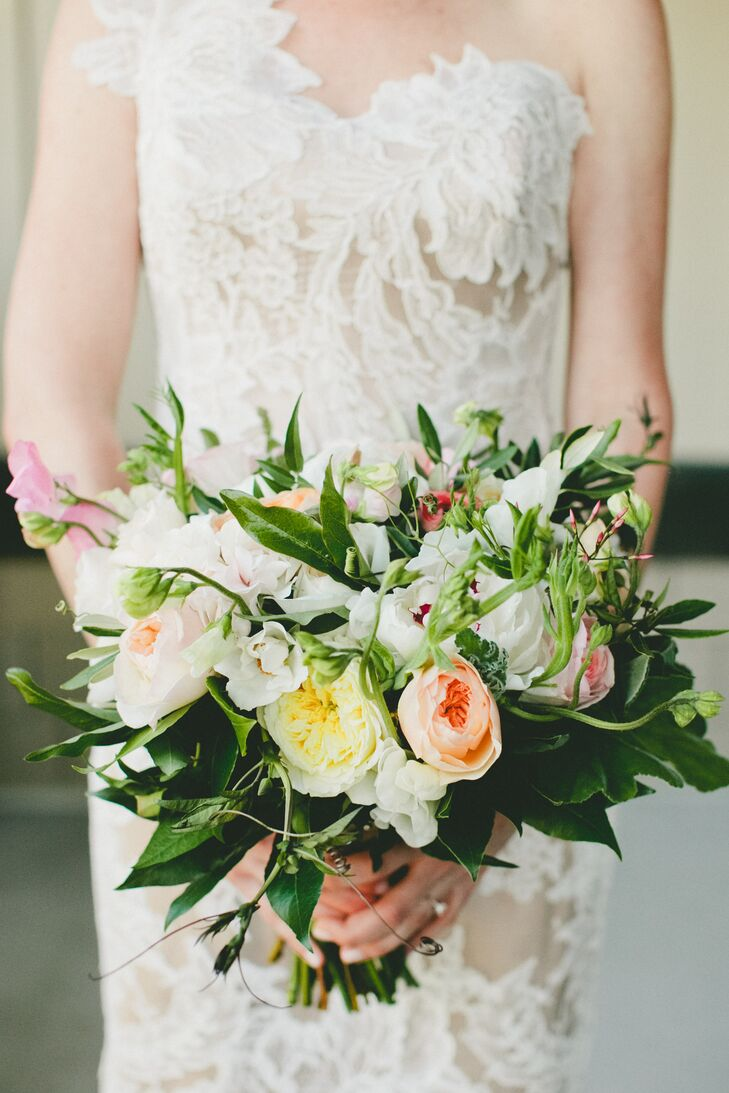 The bouquets and boutonnieres provided a bridge between the ceremony and reception decor. The wild, romantic arrangements were filled with soft neutral hues and subtle pops of color, plus plenty of green textural elements that served as a nod to the lush vineyard landscape.