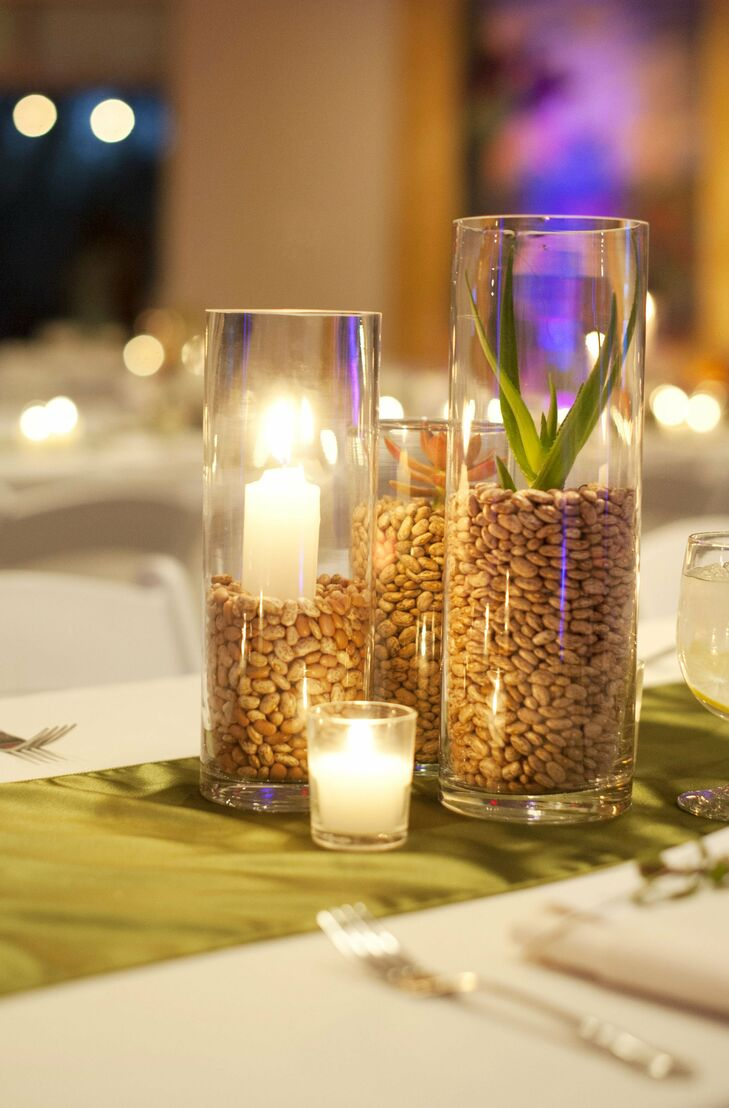 Hurricane vases were filled with candles, succulents and beans for desert-inspired centerpieces with a modern twist.