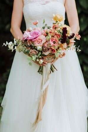 A Vintage, Whimsical Bouquet Wrapped in Lace and Ribbon