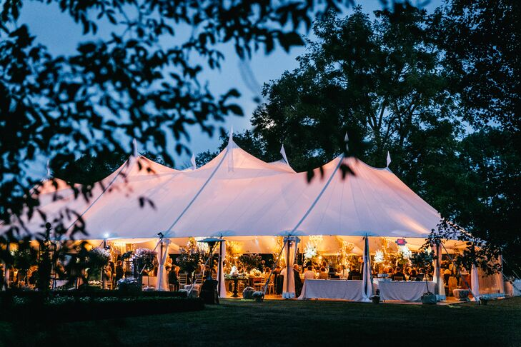 "A large tent with wooden floors housed the reception and was able to accommodate the large number of guests. ""Sean and I stepped out of the tent and just watched all our friends and family for a few minutes, in awe of how amazing it was,"" Kelsey says. ""Seeing both your families and all your friends under one roof dancing and laughing is truly magical."""
