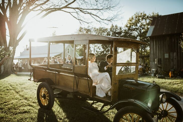 "After the ceremony, Austin and Laura hopped into a borrowed 1920s beer-delivery truck and drove down their long rocky driveway. ""It was pretty tricky to get started, but luckily Austin pulled it off. His groomsmen offered to push-start it if we got in a pinch,"" Laura says."