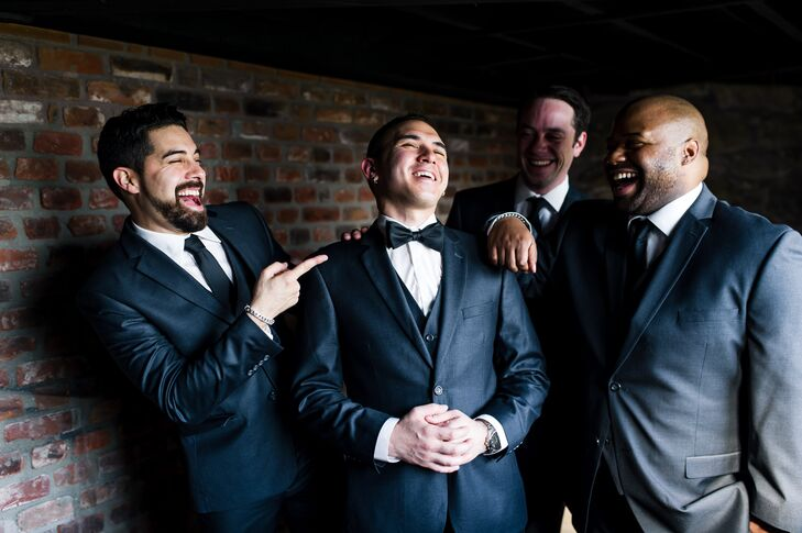 Joel, his groomsmen, and the officiant wore matching Italian style, slim fit, three-piece charcoal suits looking very dapper.