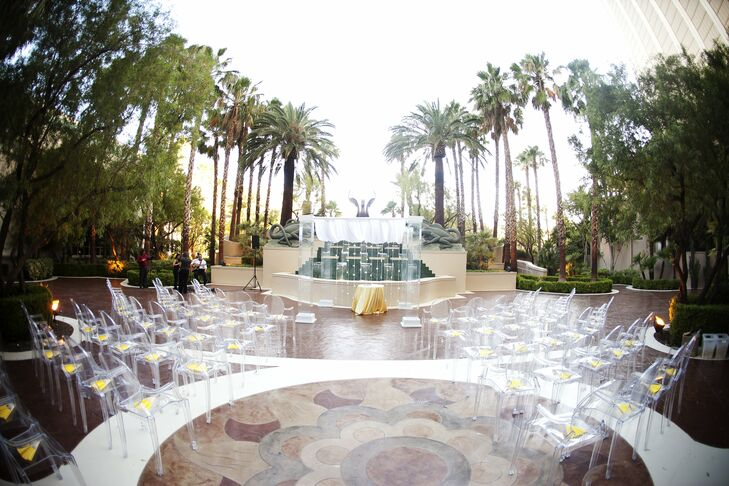 The couple exchanged vows in an outdoor ceremony at the Four Season's Fountain Terrace with a picturesque waterfall and lush greenery as the backdrop.