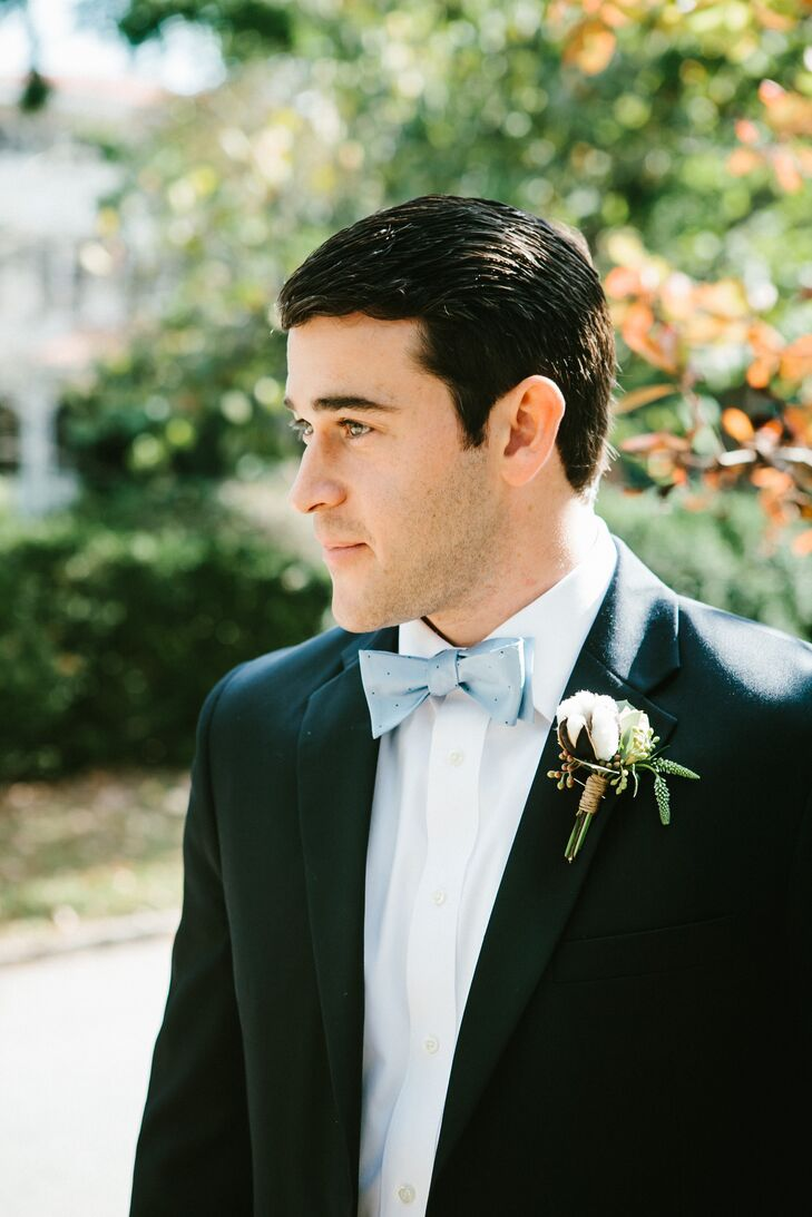 Jonathan and his groomsmen wore navy suits with custom bow ties from Jonathan's company, Brier and Moss. For some southern flair, they wore boutonnieres consisting of cotton bolls and greens.