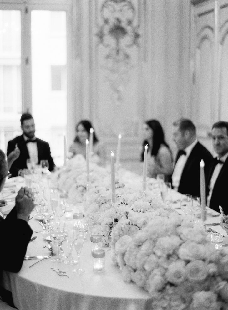 "After the ceremony, Morgan and Kevin met their 10 guests for a meal at La Maison des Centraliens in Paris, France. ""Our reception venue was very traditional French style with intricate white and gold moulding on the walls and parquet floors."