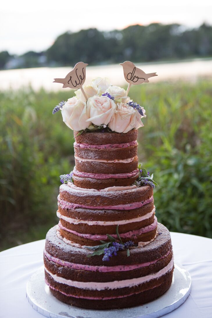The couple's three-tiered naked cake alternated between strawberry and blackberry filling that was mixed with fresh jam. Fresh flowers and two wooden birds topped the cake.