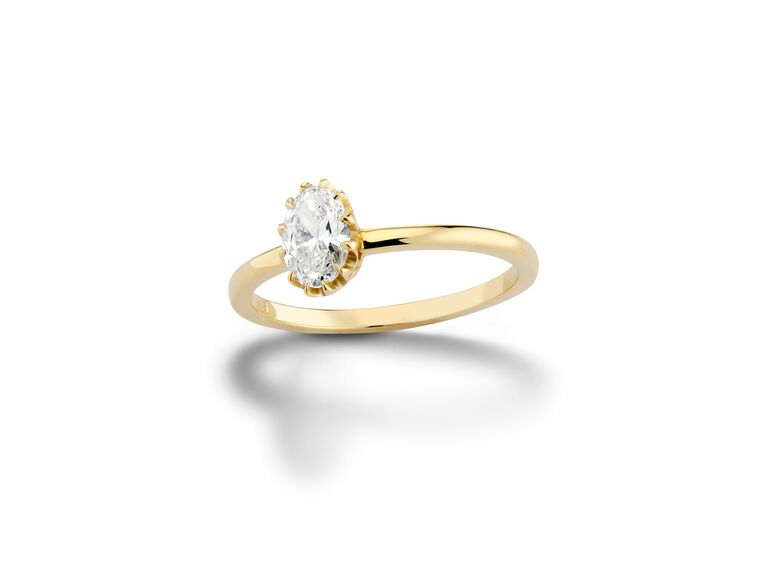oval diamond engagement ring with crown prong setting in yellow gold