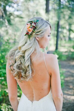 Bride in Backless Dress Wearing a Hair Clip with Flowers