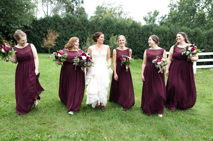 The bridesmaids wore Bill Levkoff gowns in maroon (aka wine). Sarah's gift to them was handmade dark teal clutch purses and rose gold earrings from Ava Hope Designs on Etsy.
