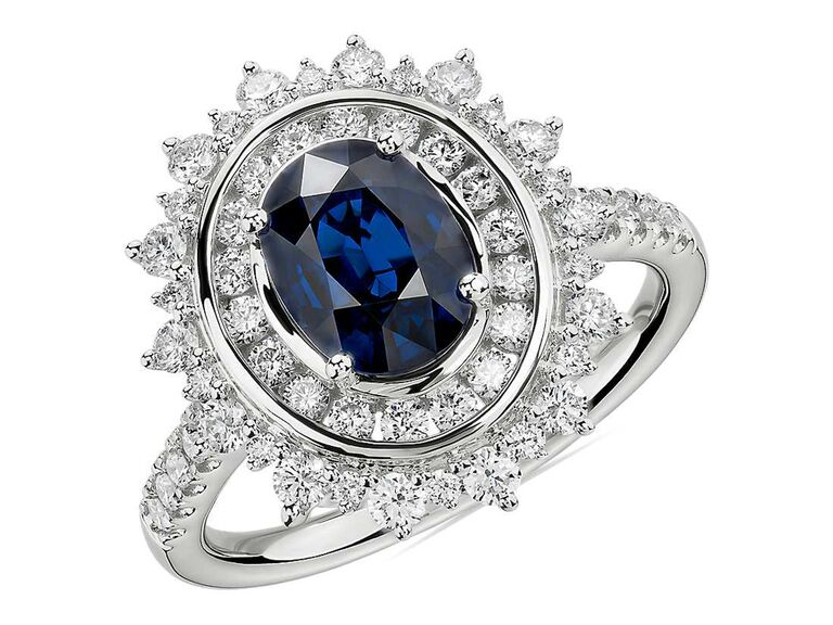 Oval sapphire engagement ring with sunburst halo