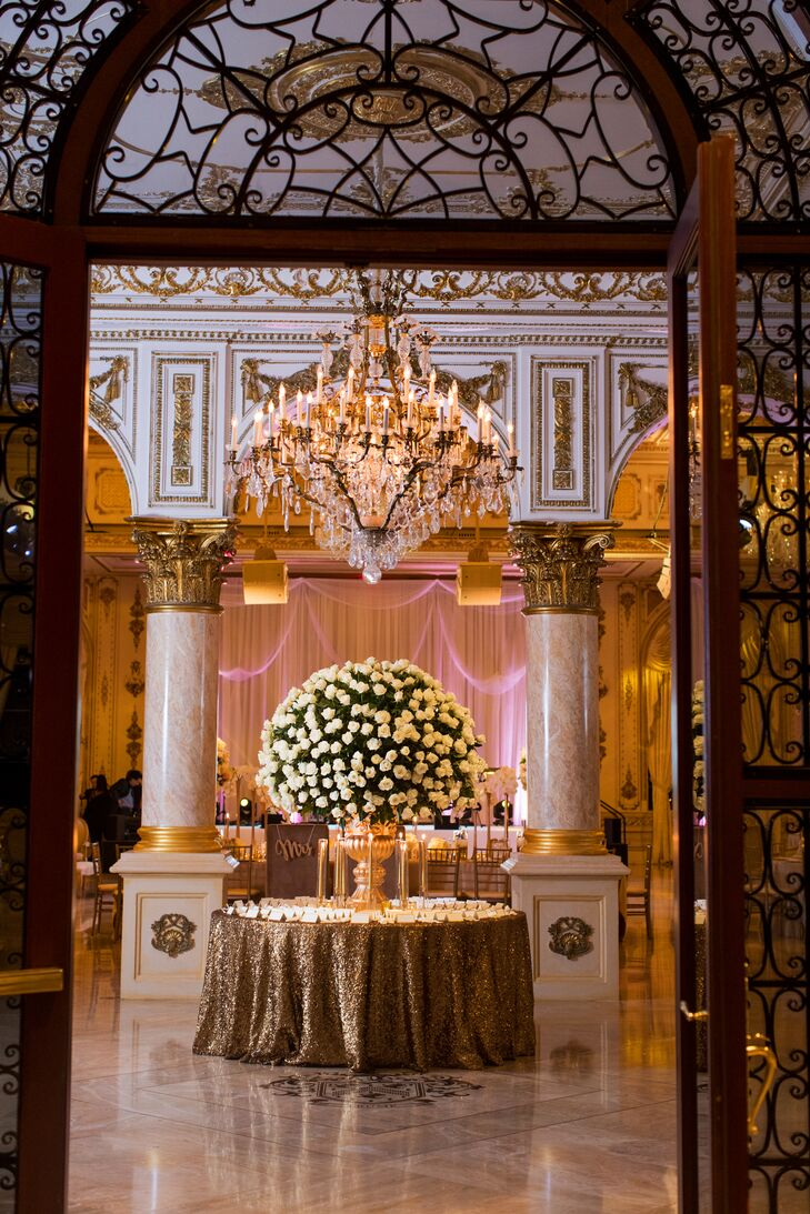 Glamorous Flower Arrangement Below Chandelier
