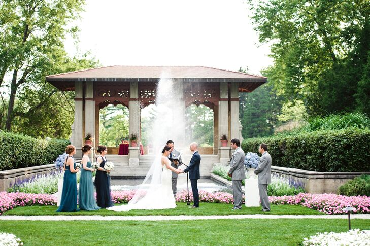"The couple exchanged vows during an afternoon ceremony in front of a beautiful pagoda and fountain. According to Lydia, ""We didn't have to decorate a lot because it was already a beautiful garden on its own with flowers blooming everywhere."""