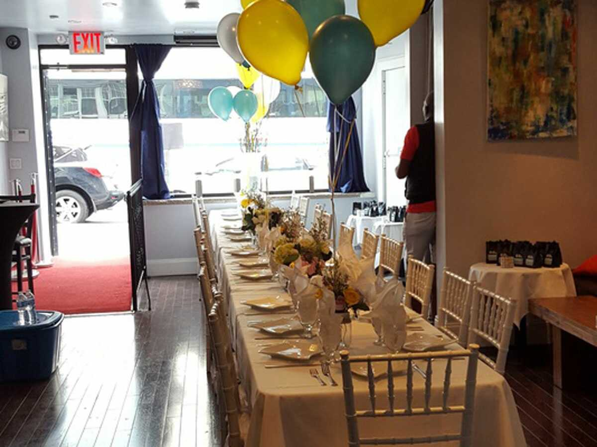 Long table with balloons set up for big party