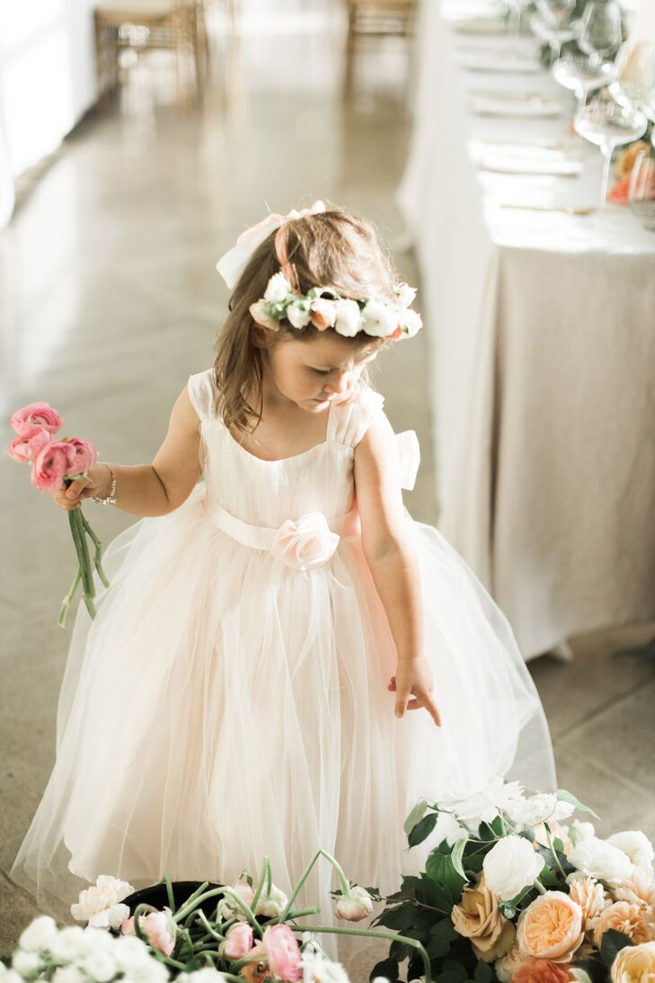 The flower girl wore a flower crown with her tulle-skirt dress.