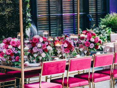 Crystal chandeliers decorated with red roses