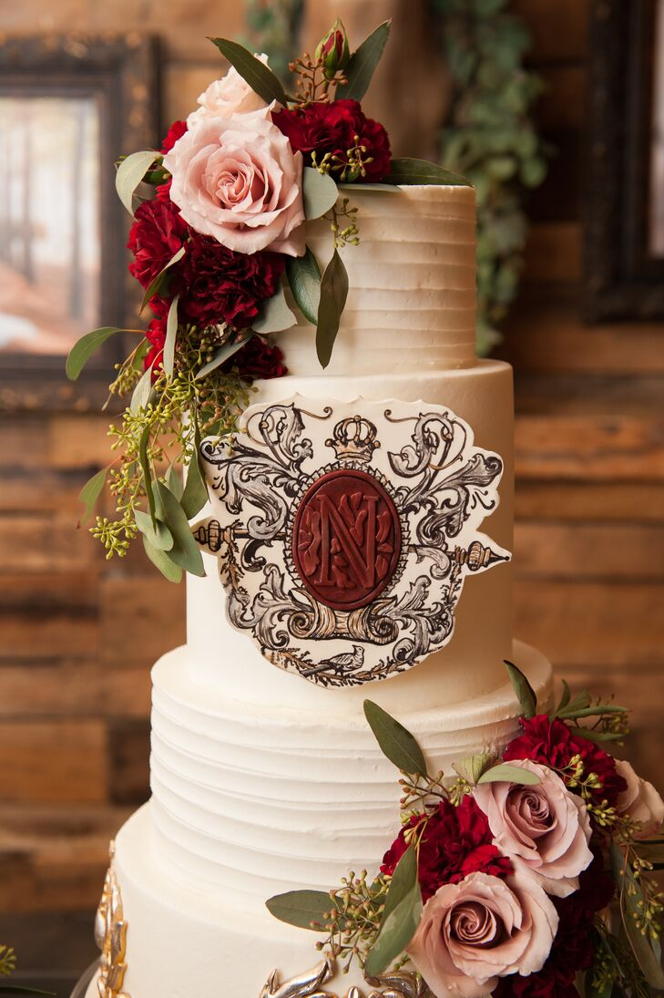 Brooklyn and Caleb featured three cakes at the reception. The largest was vanilla bean cake with buttercream icing and was adorned with a replica of their wedding crest with the bordeaux wax monogram seal mimicking the invitations and programs.