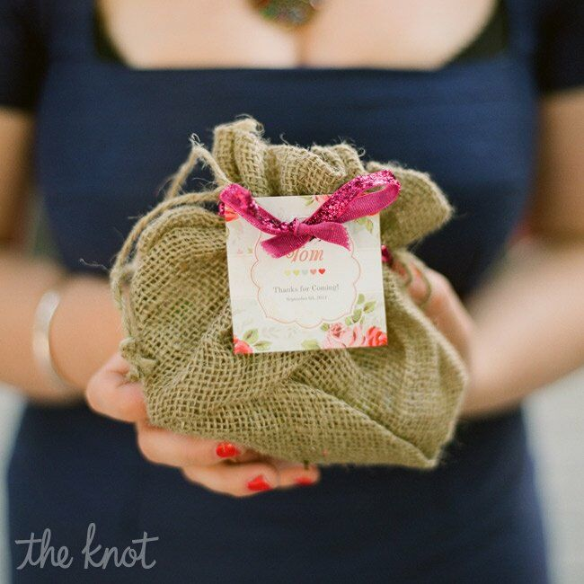 Jenna designed colorful tags that doubled as place cards and favor tags. In American wedding guests' bags, Australian staples like Vegemite and Tim Tams were placed in the burlap bags. The Australian guests got Slim Jims and Laffy Taffys in theirs.