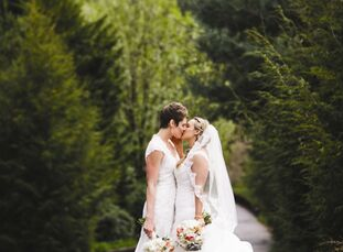 From their organic menu to a ceremony arch made from driftwood and a guest book made from river stones, Cassie and Julie gave their wedding the green