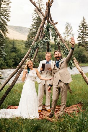 Rustic Couple at Mountain Ceremony with Triangle Arch