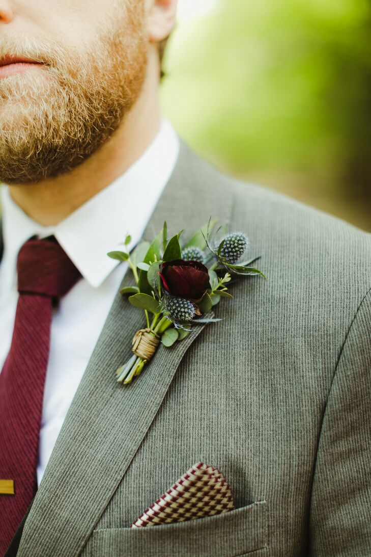 Groom's Gray Suit with Burgundy Accessories and Ranunculus and Thistle Boutonniere