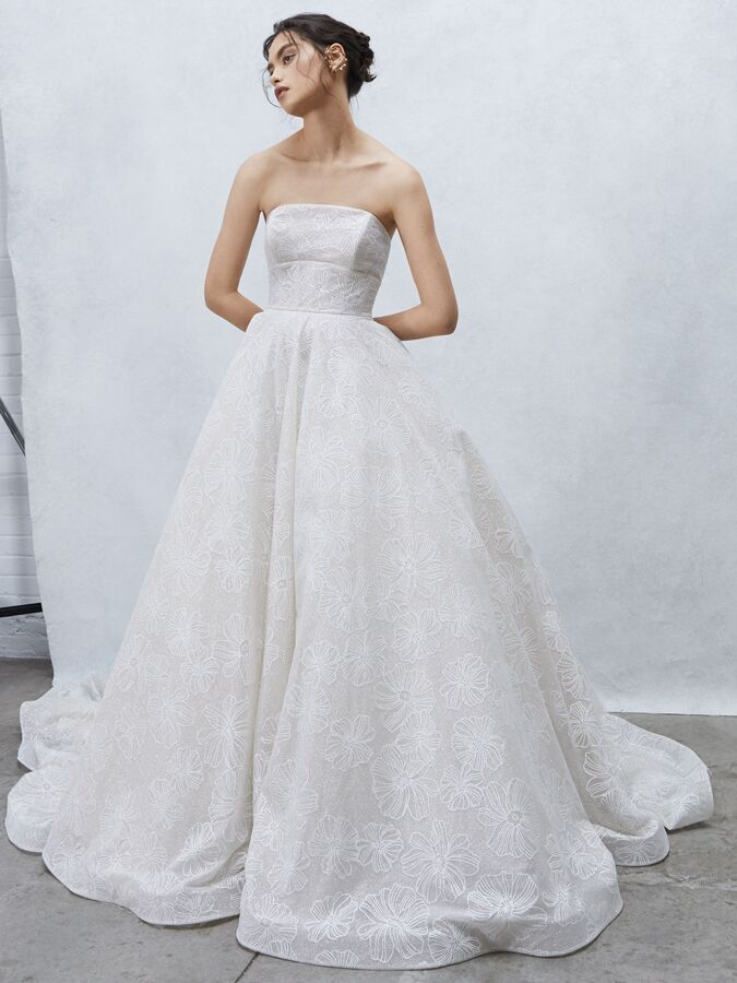 Alyne Collection strapless ball gown with floral gossamer