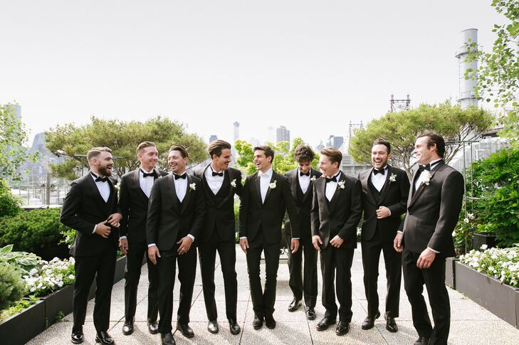 """""""I wanted all the boys to look sharp and dapper, and because there were so many of them, I knew that the safest option was a black tux,"""" Sasha says of the classic groomsmen attire."""