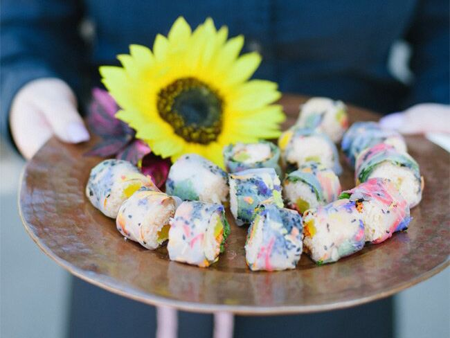 Colorful sushi rolls with sunflower accent