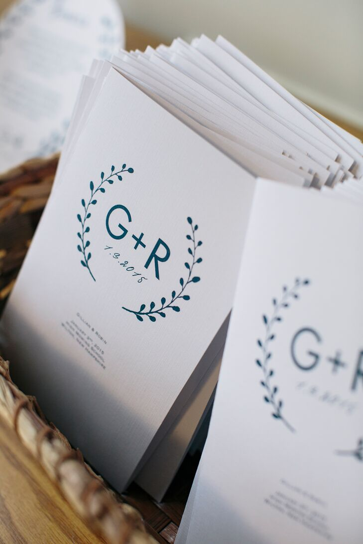 Gillian and her mother designed the ceremony programs themselves with the couple's laurel monogram printed in navy.