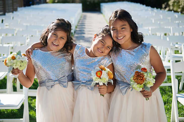 The junior bridesmaids wore sparkly silver dresses from Nordstrom. Maggie and Chance wanted to find dresses that were age appropriate and not too little girl-feeling. The dresses they chose had cream chiffon skirts with a silver bow around the waist and a sparkly bodice.