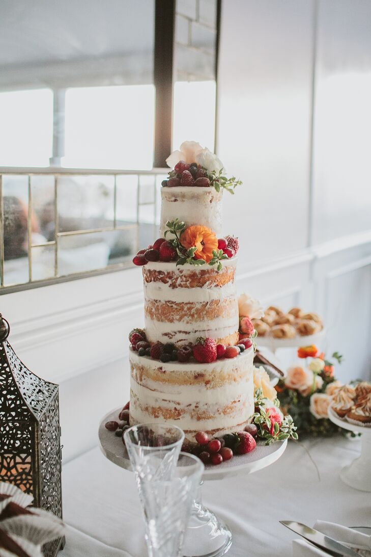 Sweet and Saucy Shop of Long Beach, California, created Gwynne and David's naked wedding cake, topping it with fresh fruit and orange blooms. Guests also dug in to a variety of mini pies and brownies.