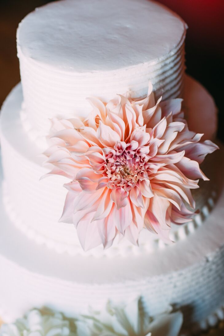 Molly and Ryan opted for a simple white wedding cake that was flavored with raspberry filling and cream cheese frosting. They also had rice krispies and raspberry chocolate truffles for dessert.