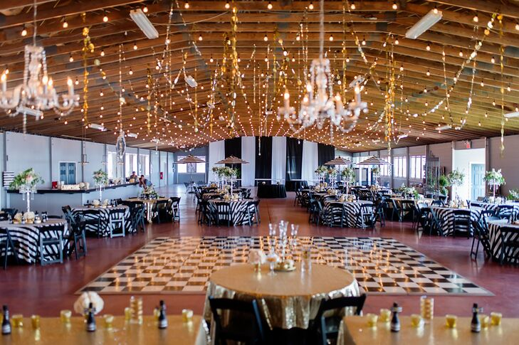 Each table was set with a black-and-white-striped tablecloth made by the bride's mother. Tables were decorated with tall, large, silver candelabras with hanging crystals and a flower arrangement of blush and ivory roses.