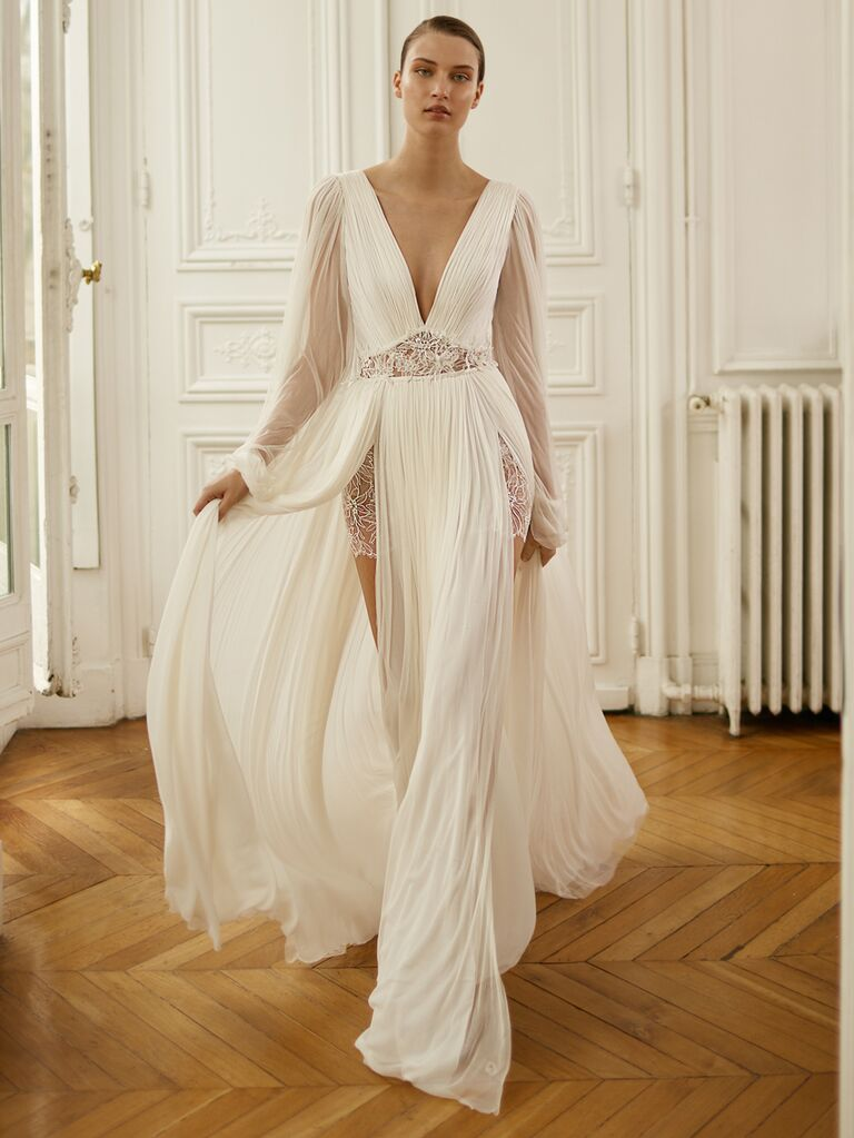 Dana Harel Spring 2020 Bridal Collection wedding dress with sheer long sleeves and lace panels