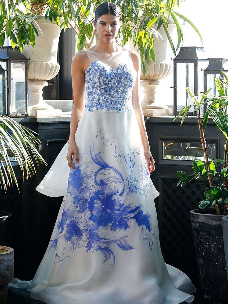 White wedding gown by Francesca Miranda​ with blue floral details