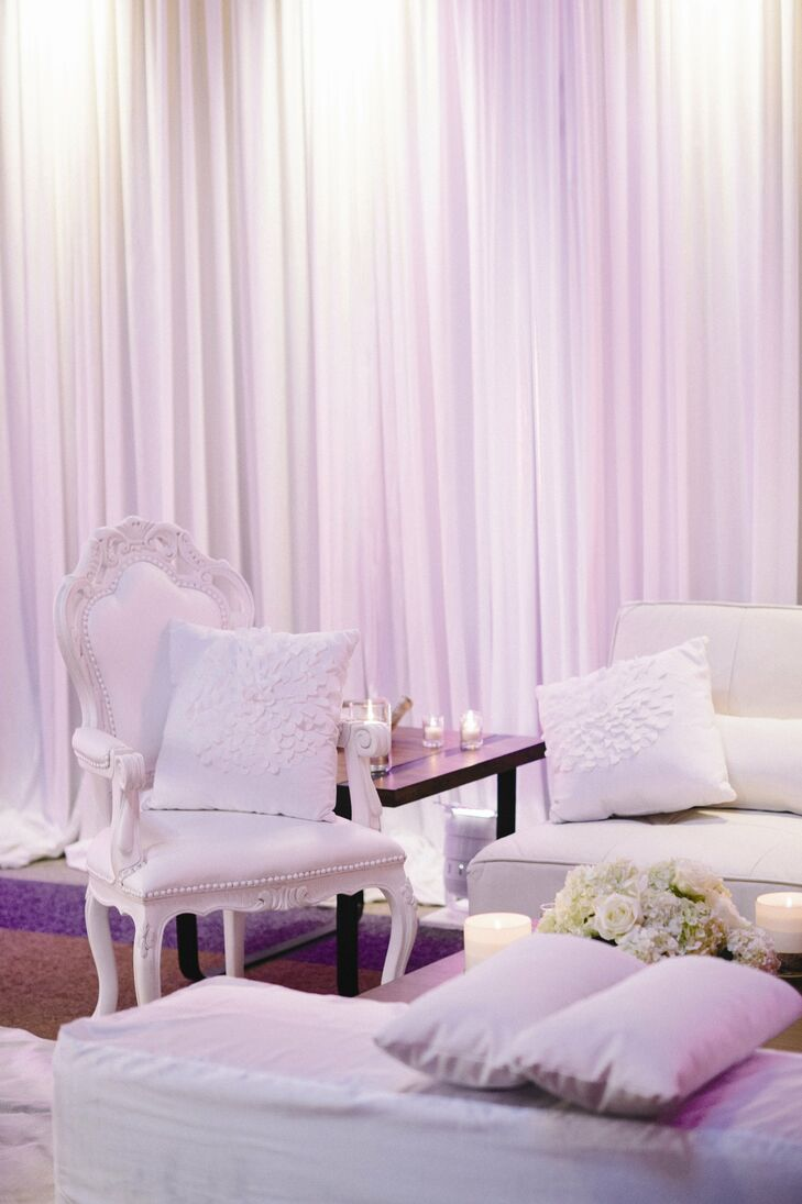 White armchairs and couches added a modern, elegant vibe to the lounge area.