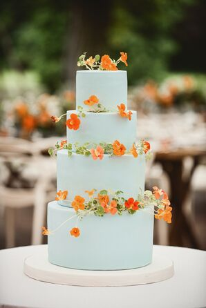 Tiered Blue Wedding Cake with Fresh Orange Flowers